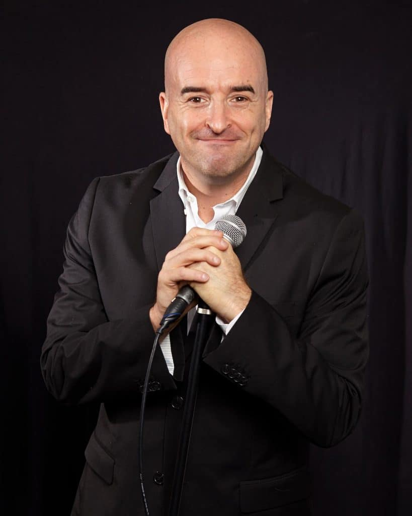 Hire a professional clean comedian to infuse laughter and joy into your corporate office
